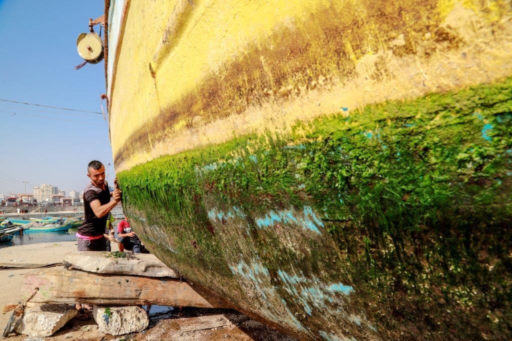 Boat repairs in Gaza's fishing port. Photo by Asmaa Elkhaldi
