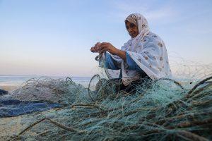 Etedal Al Sheikh, works in Gaza's fishing sector. Photo by Asmaa Elkhaldi
