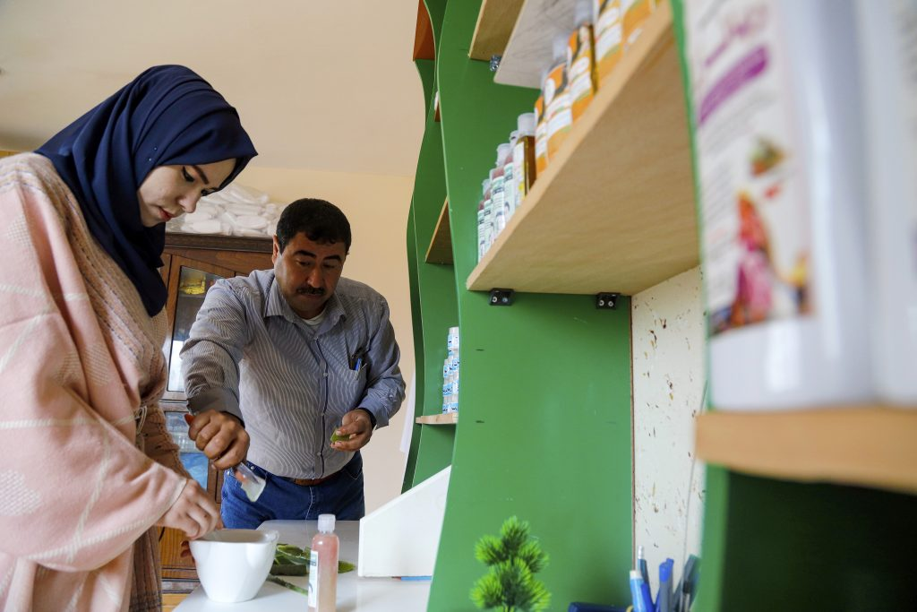 Basma and her father make a product.