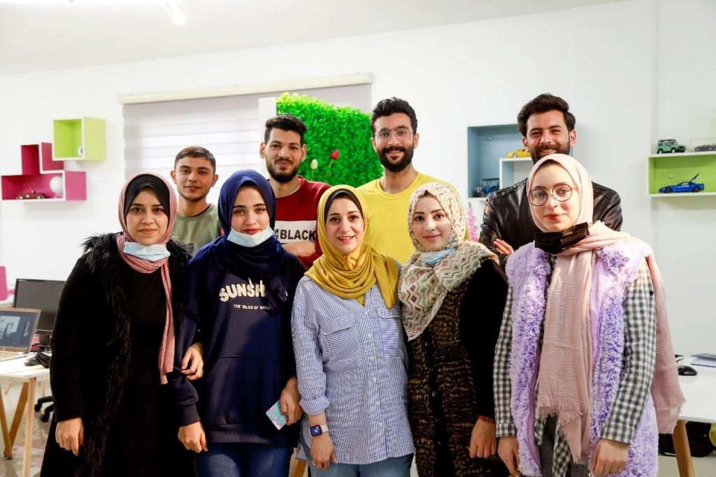 """Rozan and the """"Rosa"""" team in their office in Gaza City. Photo by Asmaa Elkhaldi"""